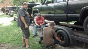 Trevor (Standing) Randy (Sitting) Kyle (Working on tire)