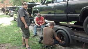 Trevor (Standing) Randy (Sitting) Kyle (Working on tire)