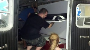 Austin and Lorie raising the bunk into place for the first time.