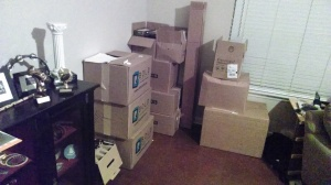 Linens, safe, and SOME of  the other goodies donated by HURT fans stacked at my house, waiting to be put in Pandora's Box.