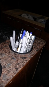 No tour bus is complete without a cup holder full of sharpies for autographs.